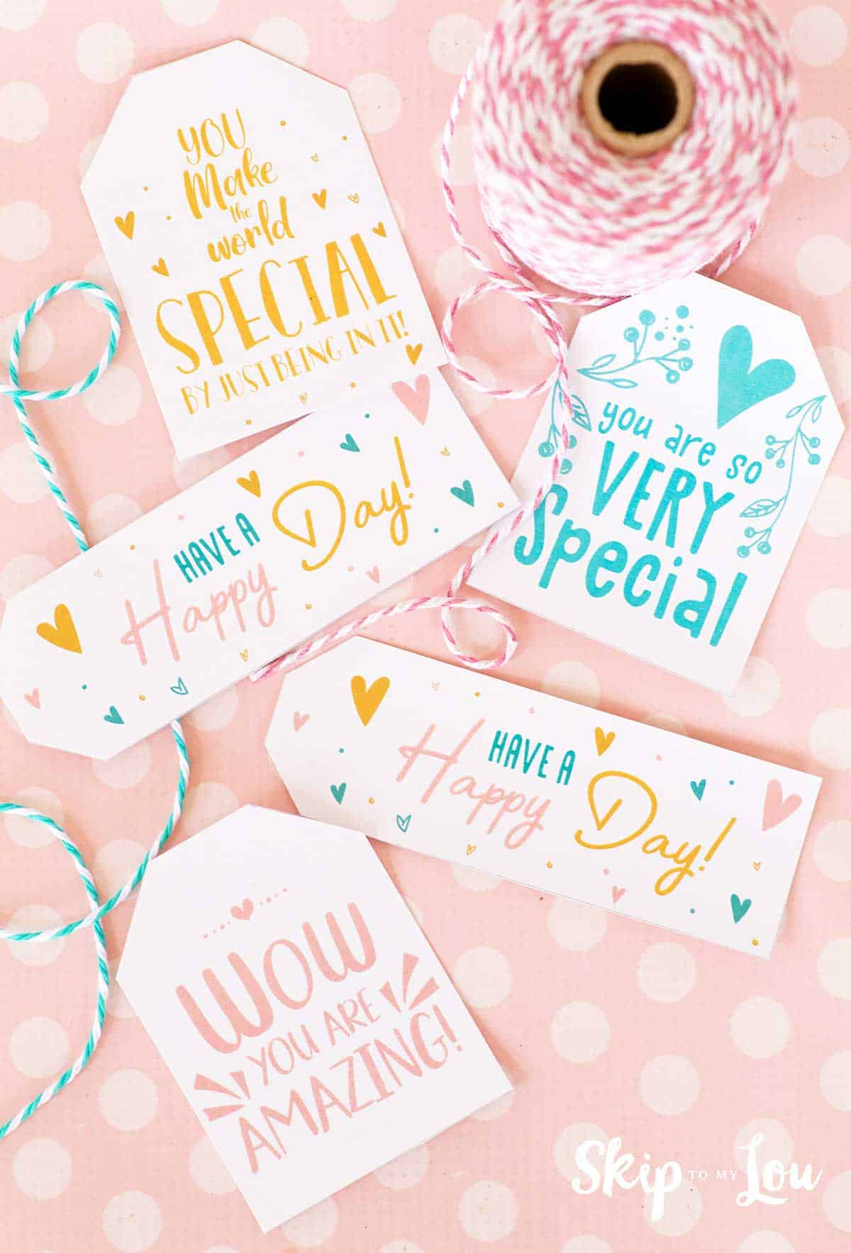 printable gift tags on pink background with twine at side