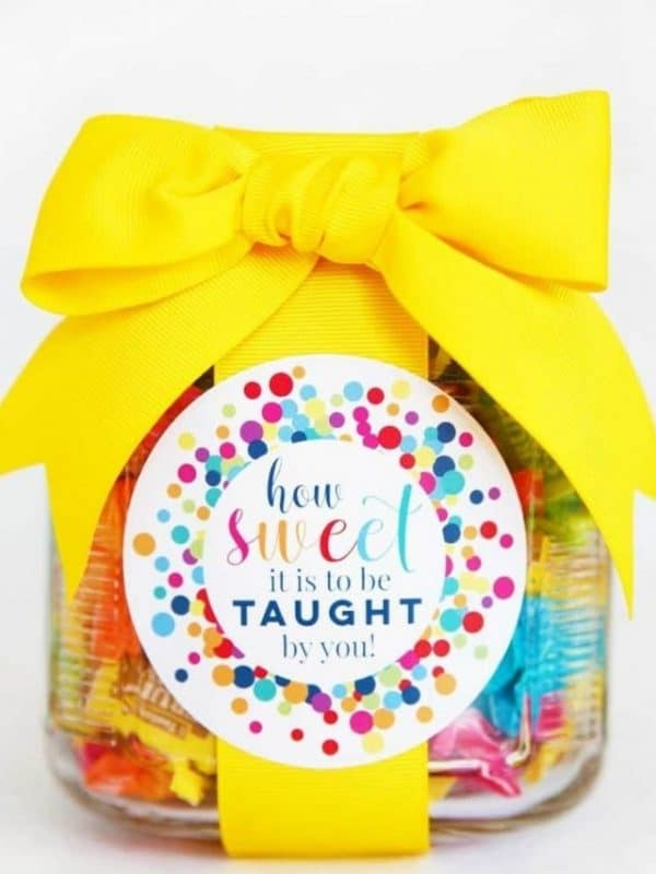 jar filled with candy yellow ribbon and label how sweet it is to be taught by you