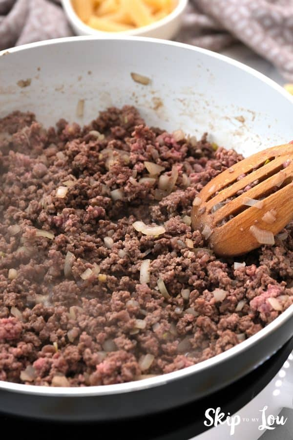 ground beef or sausage and onion browning in a skillet