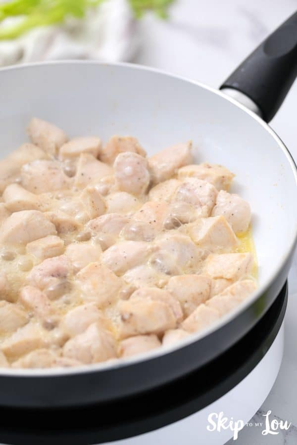 chicken placed in cooked onion and cream mixture