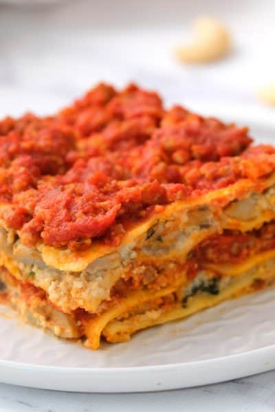 layered gluten free dairy free lasagna served on a white plate