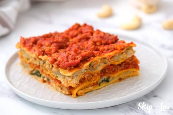 layered gluten-free dairy-free lasagna served on a white plate