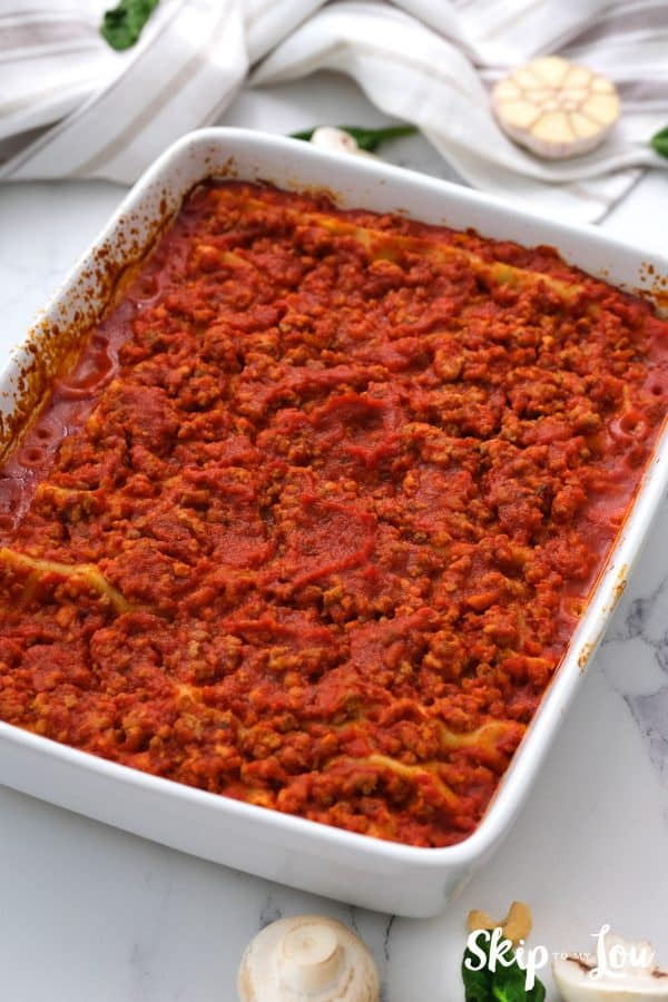 a white casserole dish of baked gluten free dairy free lasagna all ready to serve