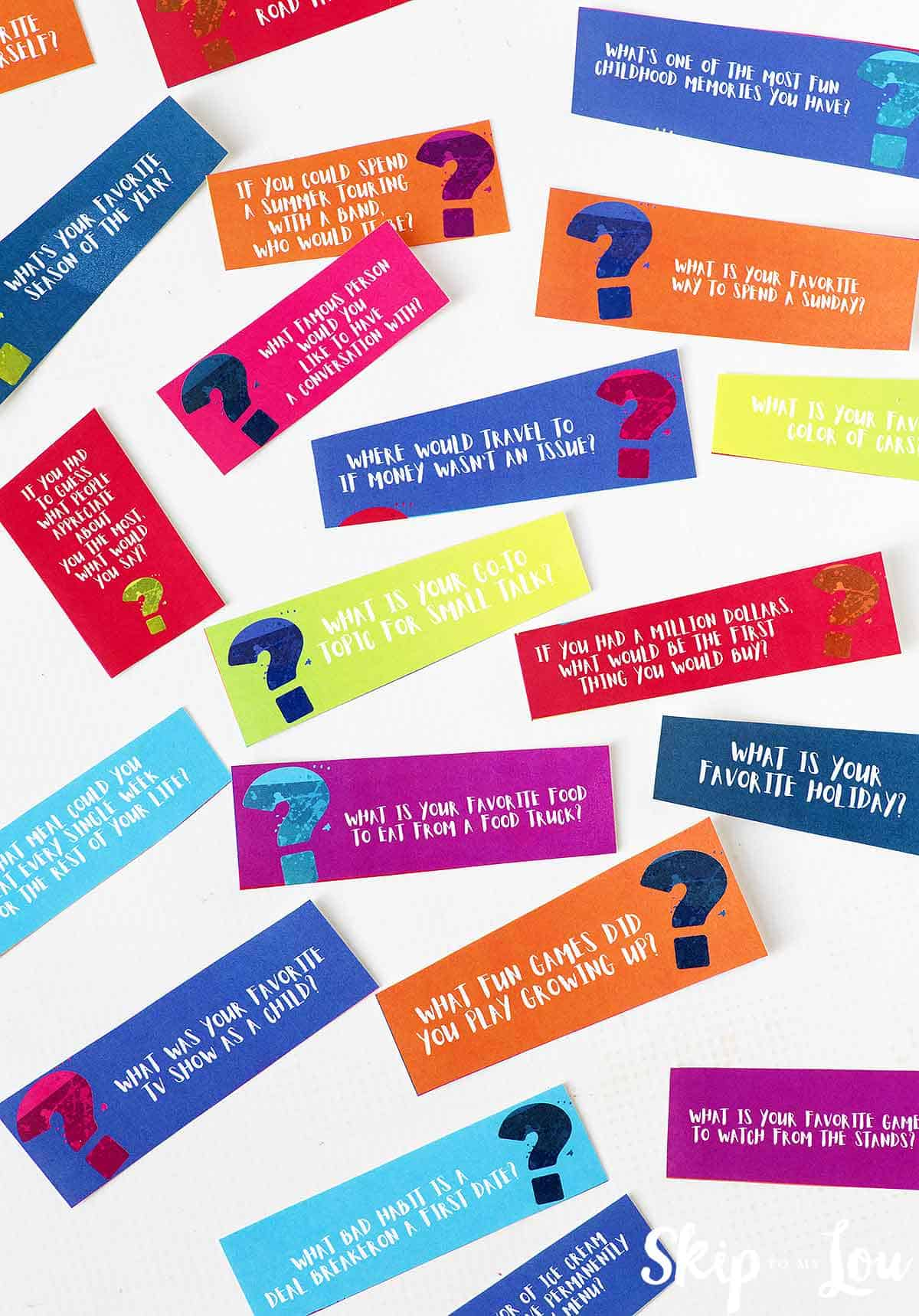 colorful 21 questions cards on white background