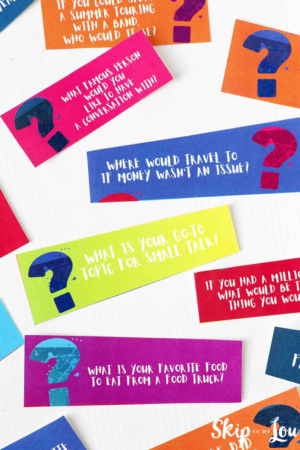 colorful cards with questions printed on them to play 21 questions