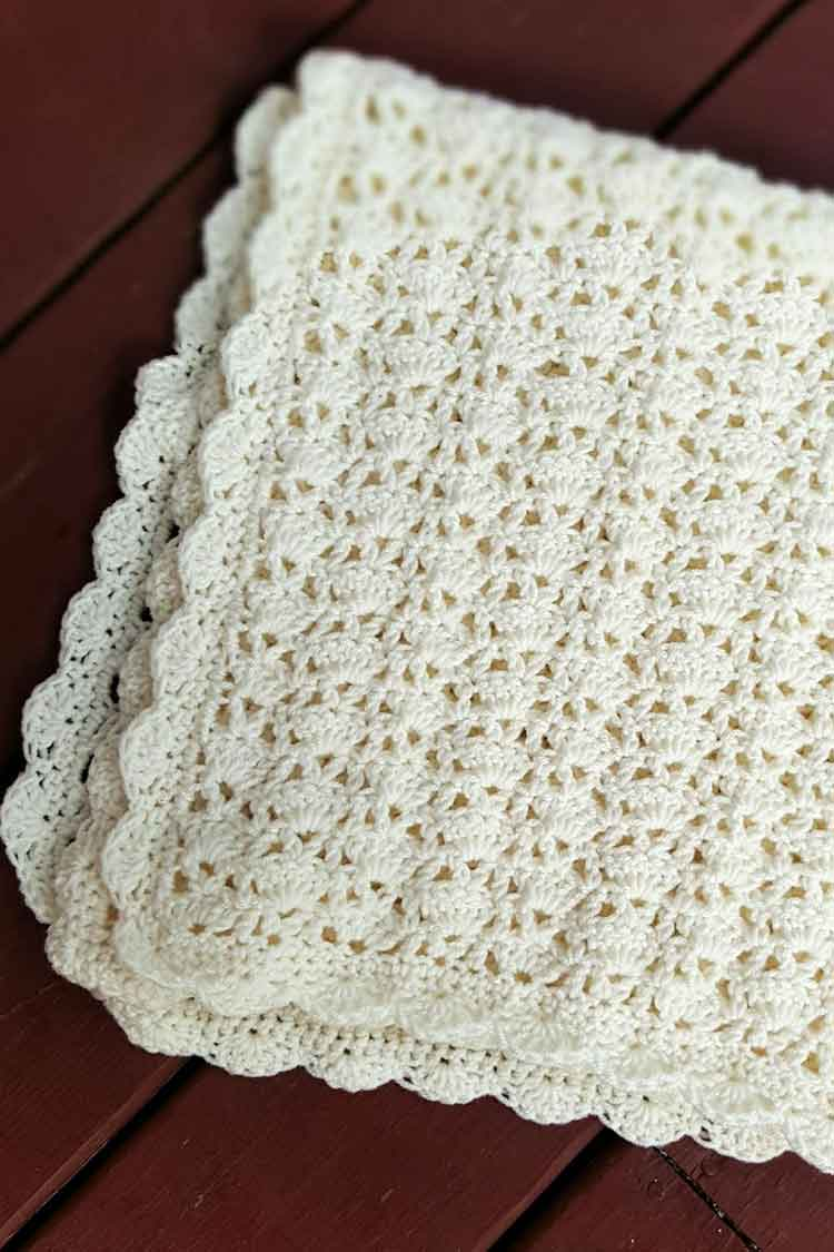 white lacy blanket with shell border