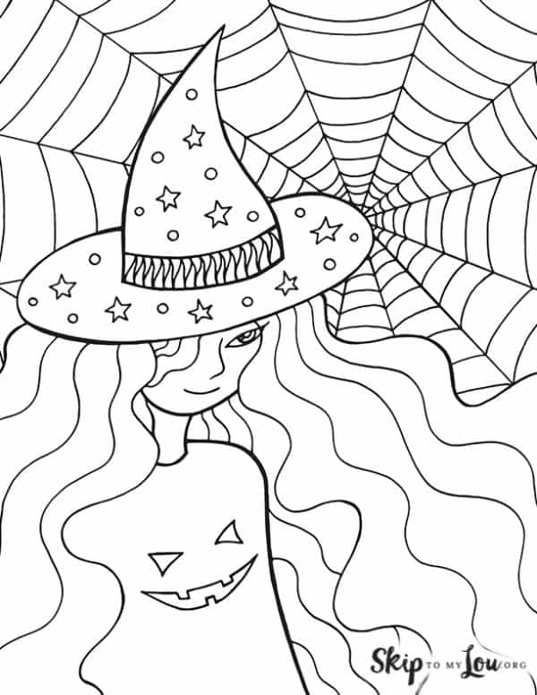 witch with spider web and wearing jack o lantern shirt