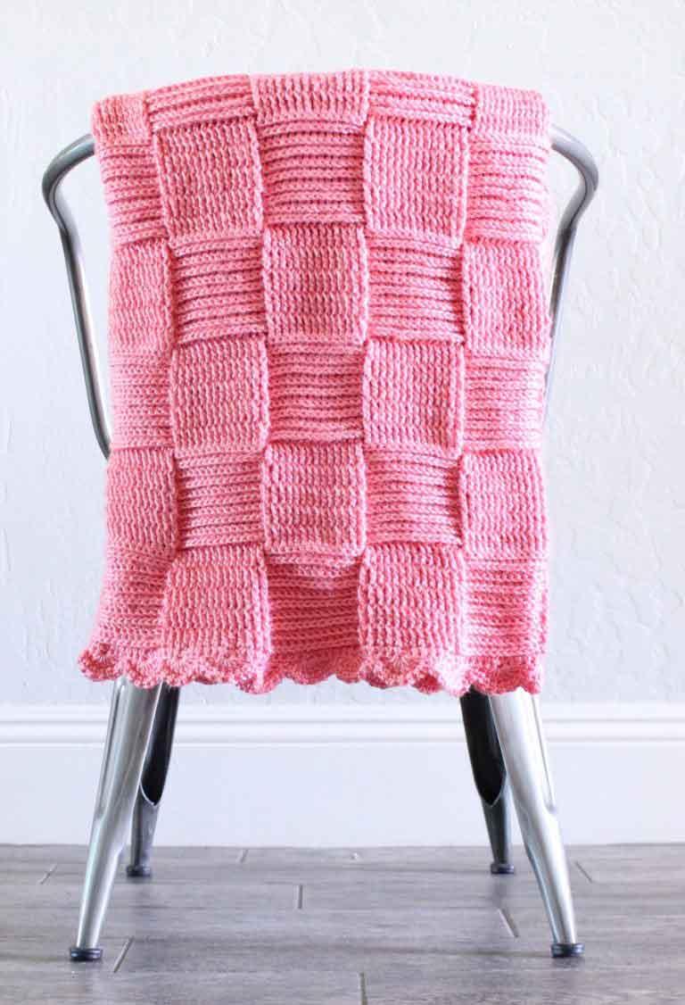 pink basket weave blanket on metal chair