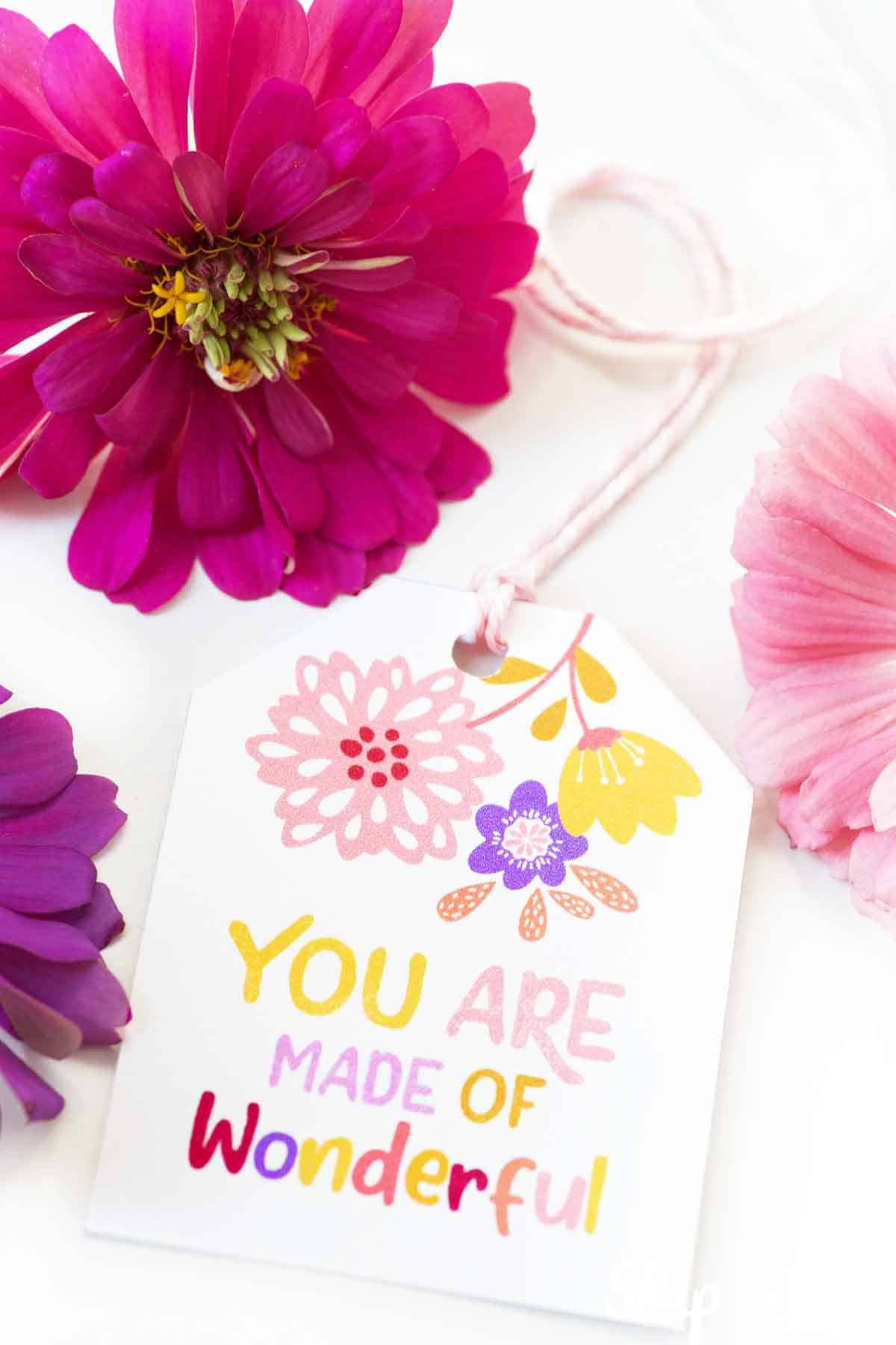 you are made of wonder free printable gift tag with flowers to the side