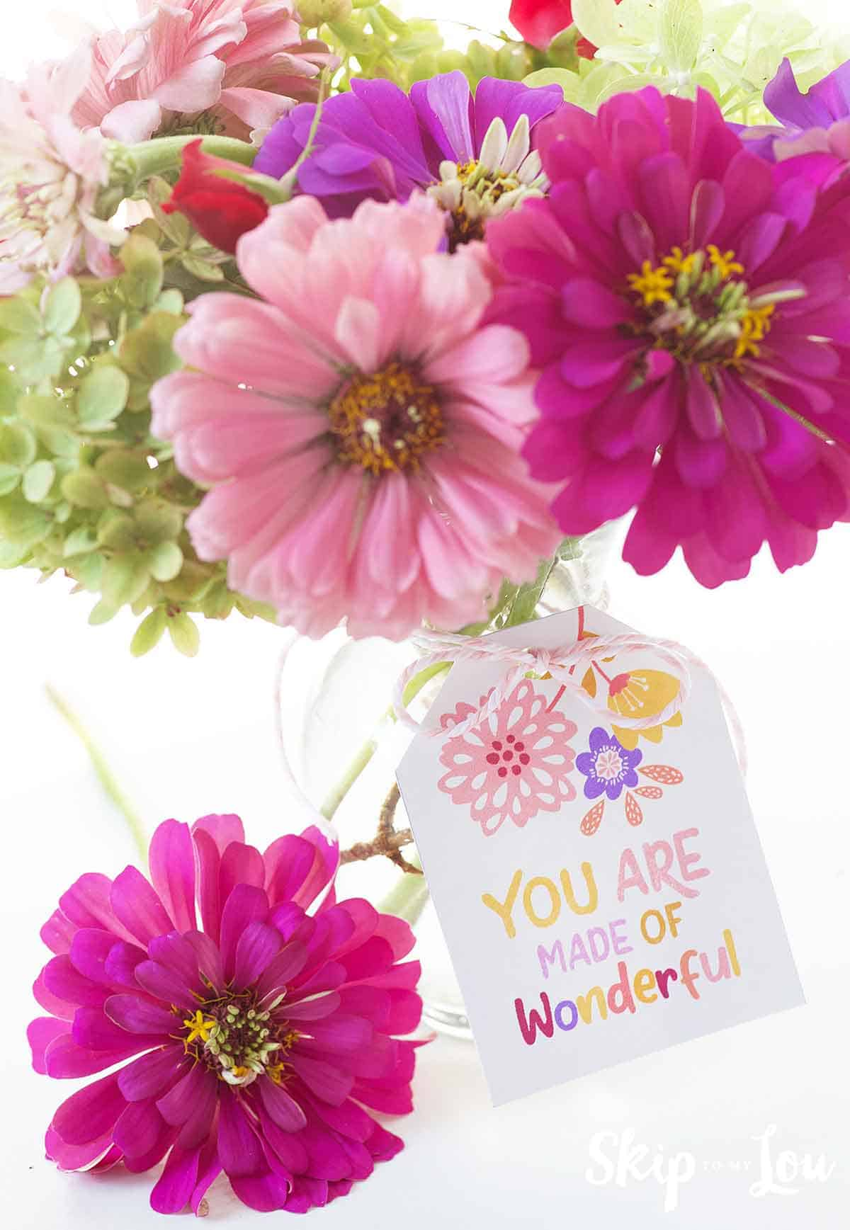 flowers in vase with you are made of wonderful gift tag tied to the vase one flower laying to the side