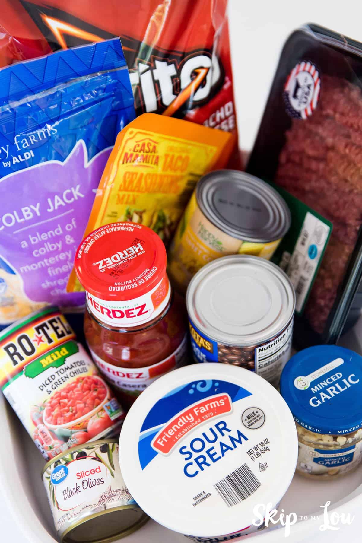 doritos casserole ingredients beans sour cream salsa cheese Doritos