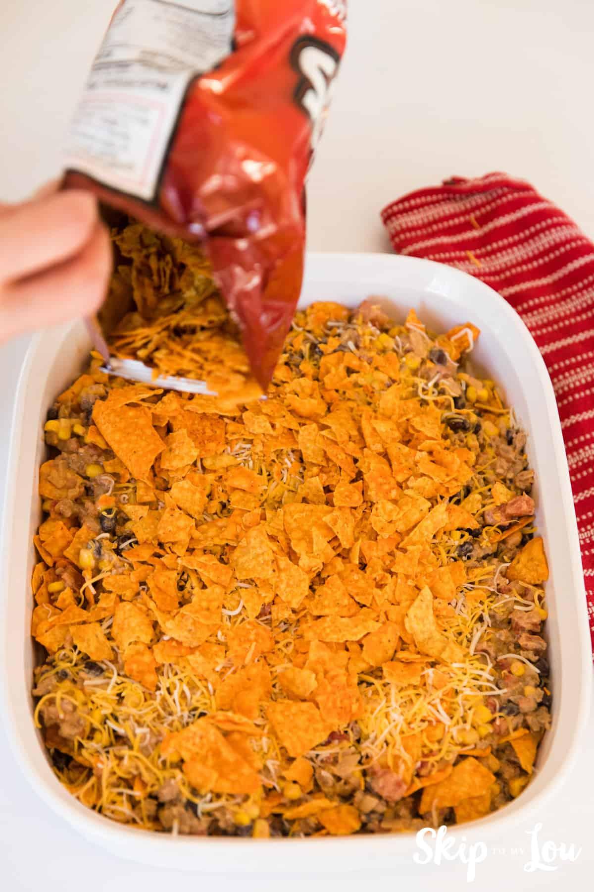 placing doritos on top of Mexican casserole