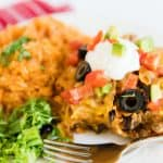 Doritos Casserole recipe on plate with side of rice